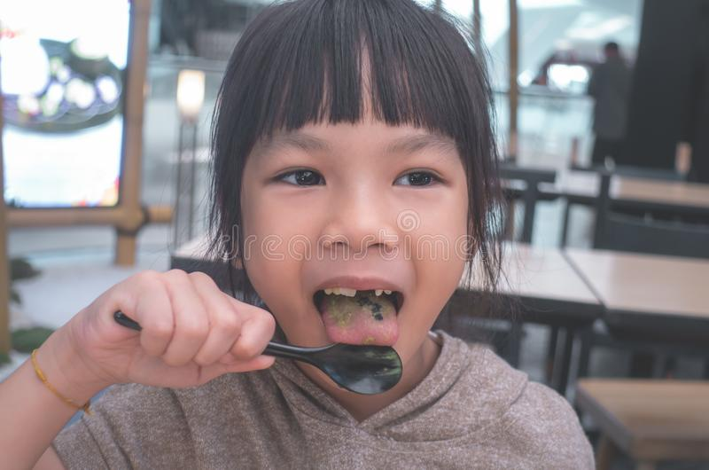 Asian girl eating Japanese green tea ice cream royalty free stock photo