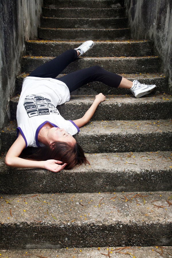 Asian girl fallen down steps royalty free stock images