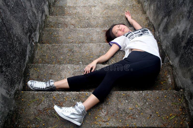 Asian girl fallen down steps stock images