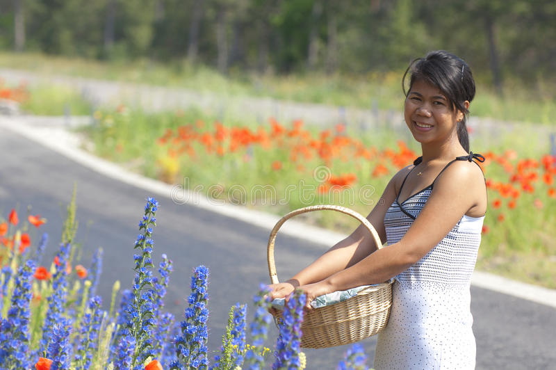 Download Asian girl and flowers stock image. Image of standing - 19868877