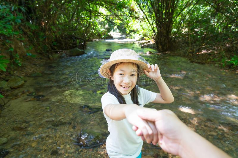 Asian girl in forest at stream,cute little girl studying and lea stock image