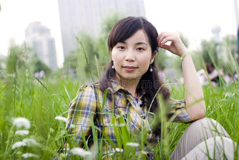 Asian Girl In Grassland Royalty Free Stock Photos
