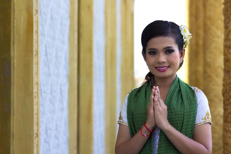 Asian Girl Greeting in Temple royalty free stock image