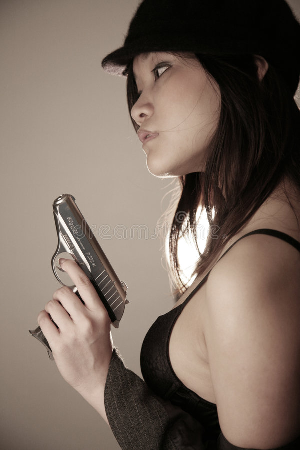 Asian girl with a gun royalty free stock image