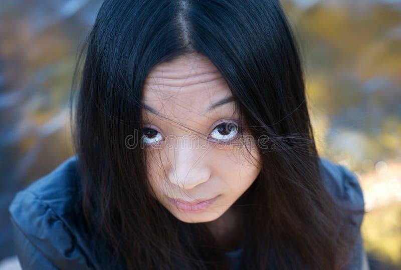 Asian girl with hair on face