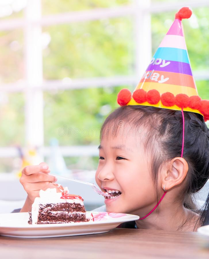 Asian girl happy eating her birthday cake royalty free stock images