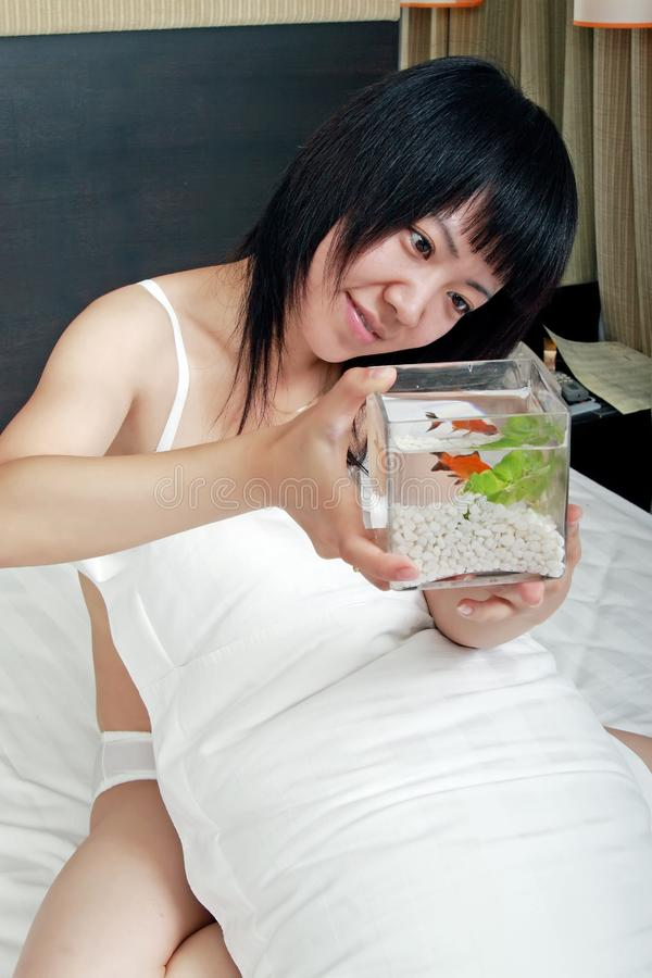 Download Asian Girl With Her Goldfish Stock Image - Image of underwear, glass: 9772353