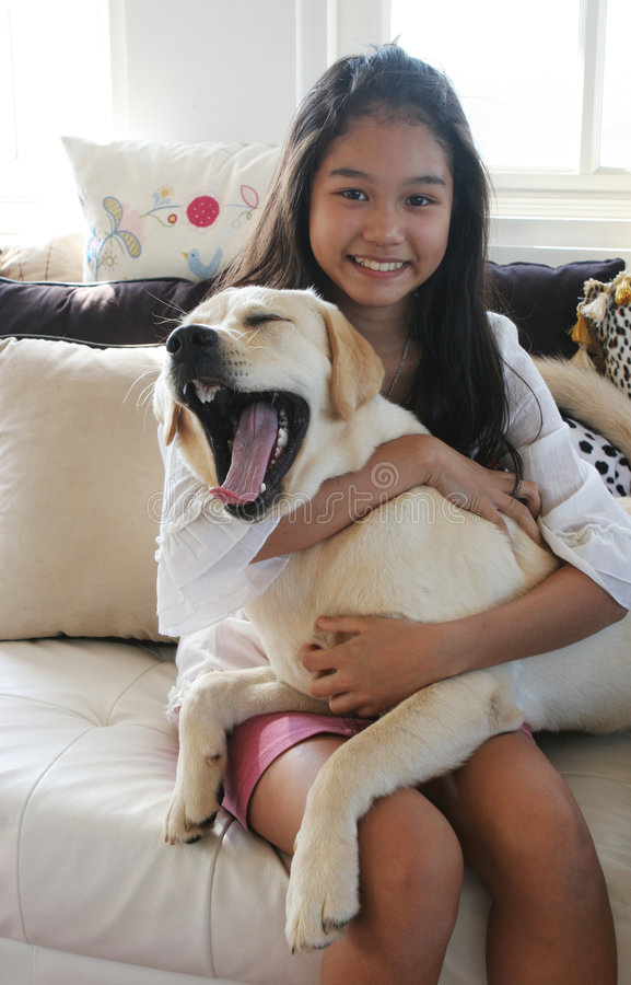 Asian girl with her yawning dog royalty free stock photography