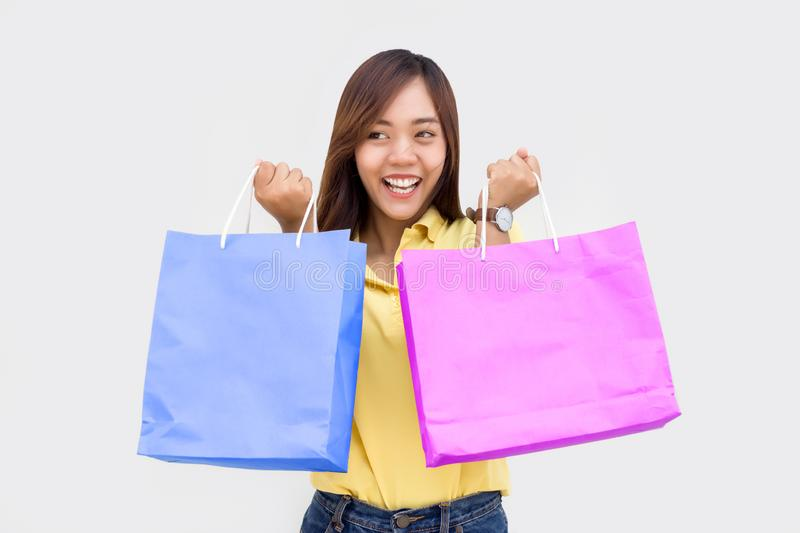 Asian girl hold shopping paper bag and mobile on white stock photos