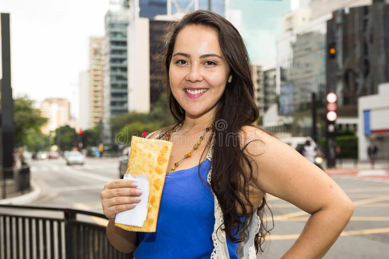 Asian girl holding brazilian snack known as Pastel - asian recipe stock photography