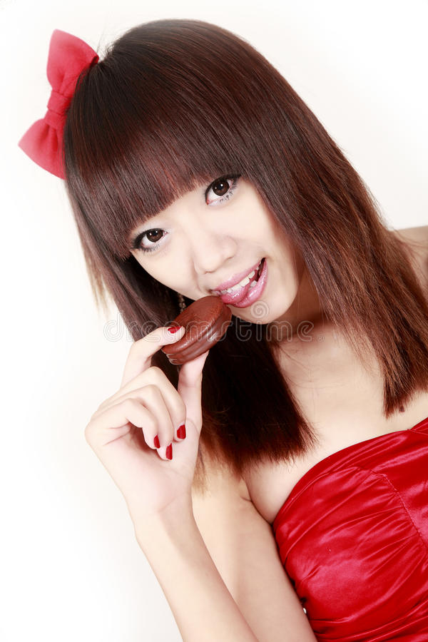 Asian girl holding chocolate pie stock photography