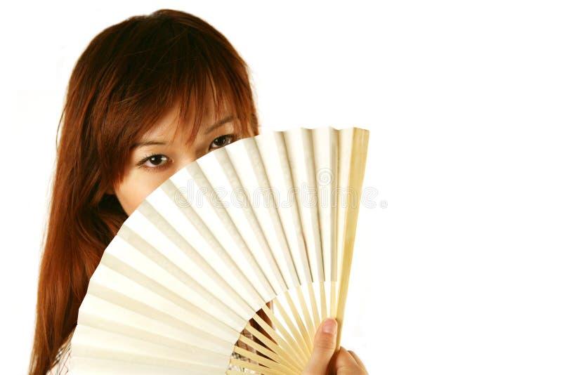 Asian girl holding fan stock photo