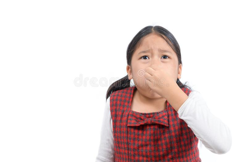 Asian girl holding her nose because of a bad smell isolated stock image