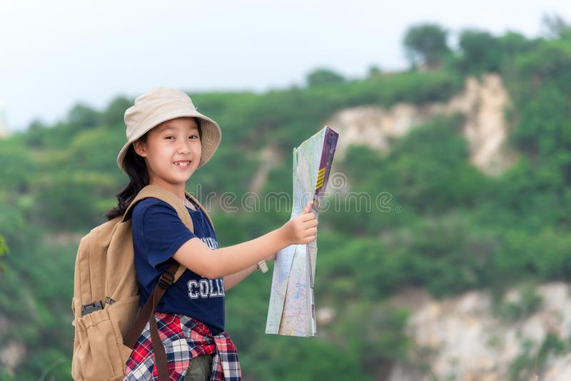 Asian girl holding map for check location adventure, tourism for destination leisure trips for education and relax in outdoors on stock photos