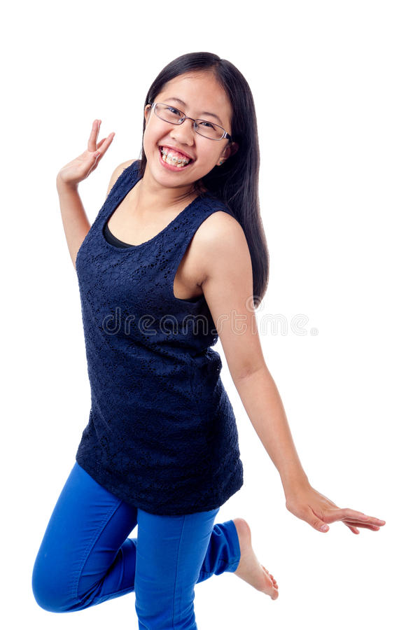 Free Asian Girl In Braces Striking A Pose Stock Images - 42953084