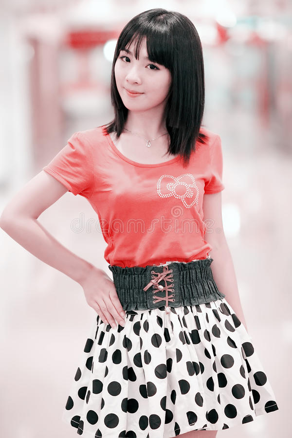 Asian girl indoor portrait. Charming Asian girl posing indoor portrait. (in a mall stock photography