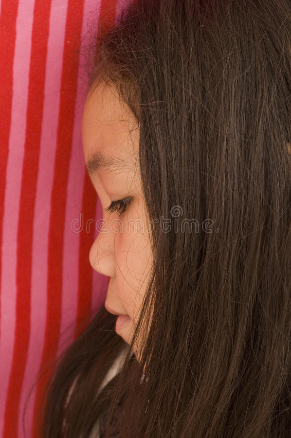Asian Girl Looking Down royalty free stock photo