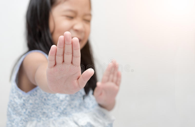 Asian girl making stop gesture with her hand stock photography