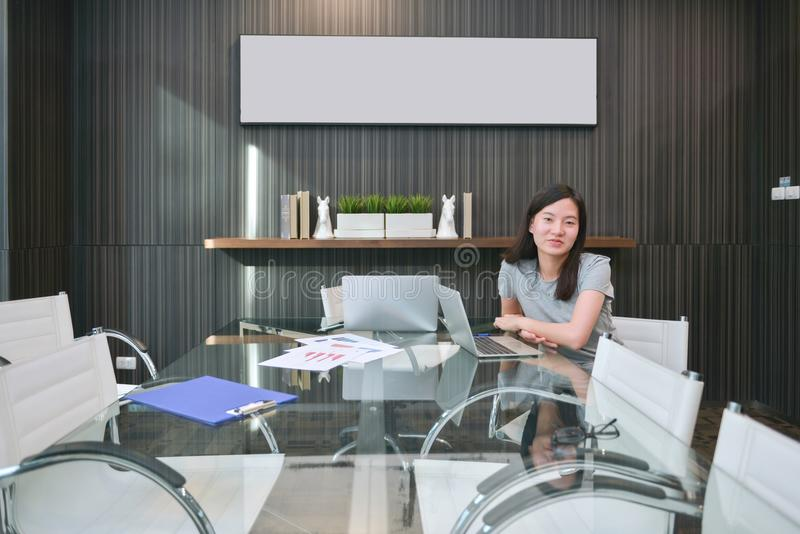An Asian girl in meeting room in business concept with blank pic stock image