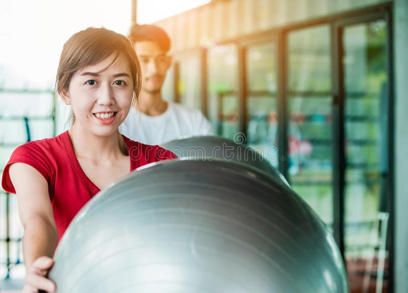 Asian girl and man exercises royalty free stock image