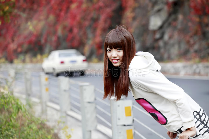 Download Asian girl in outing stock photo. Image of leaves, china - 21505266