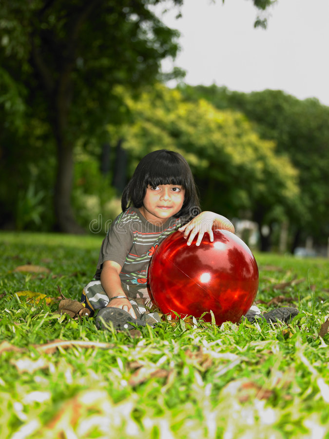 Asian girl in the park with her ball stock photo