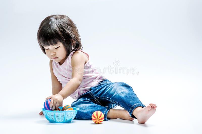 Asian girl play colour ball stock photography