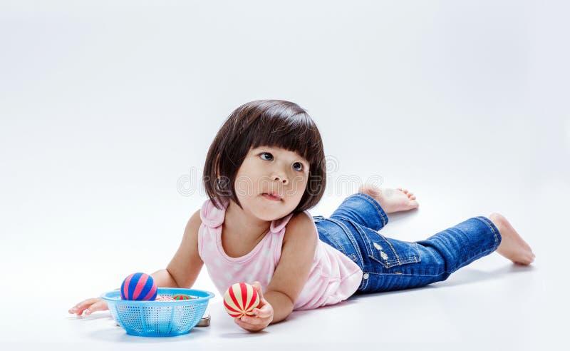 Asian girl play colour ball royalty free stock image