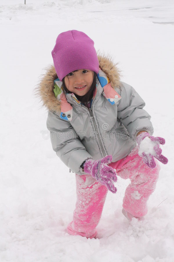 Asian Girl Playing in snow stock image