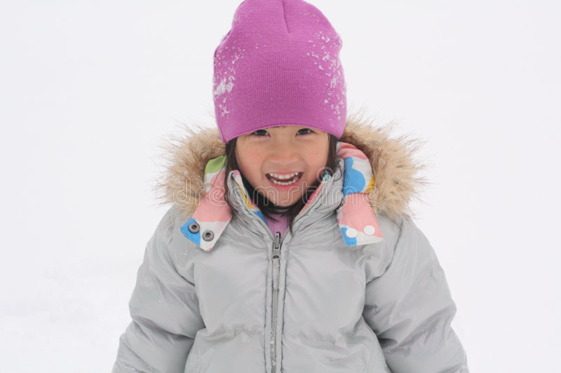 Download Asian Girl Playing in Snow stock image. Image of snow - 8432807