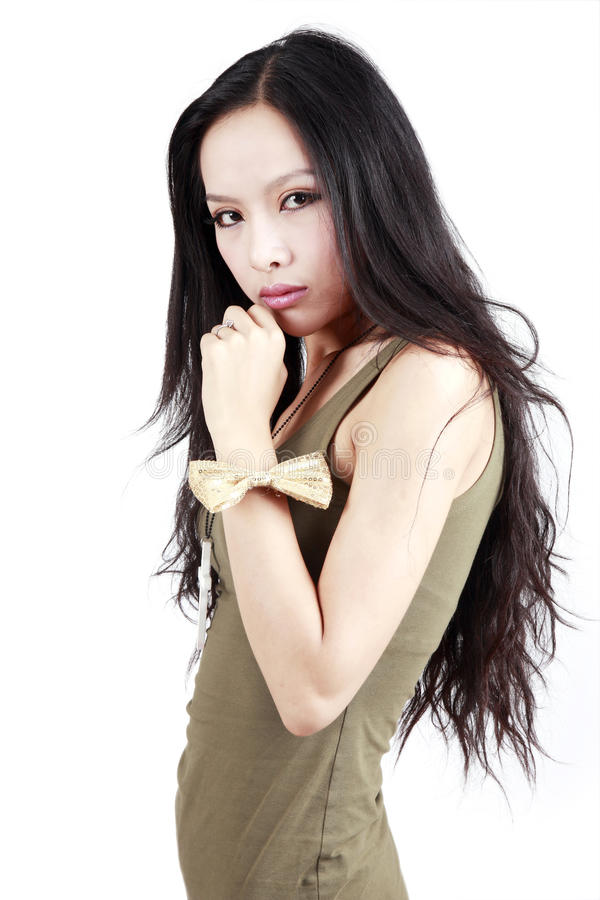 Asian girl portrait. Asian fashion girl posing on white. She is a professional model royalty free stock photography