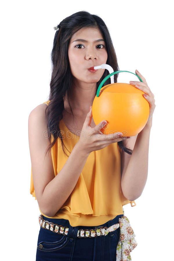 The Asian girl quench thirst. Isolated Yong Asian Woman With colorful the girl quench thirst stock photography