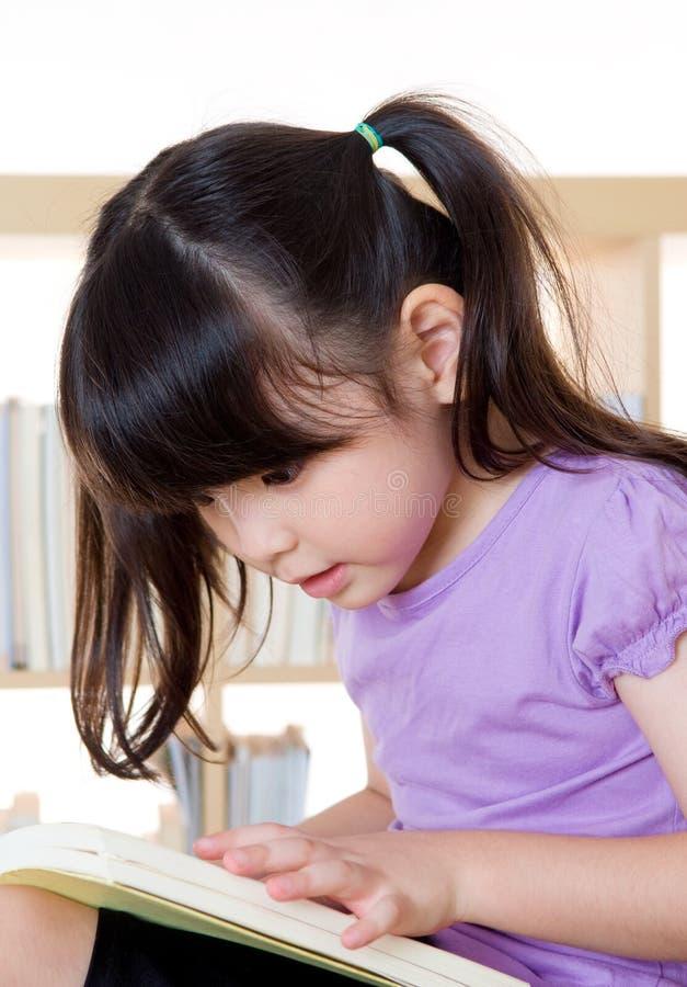 Asian girl reading stock photo