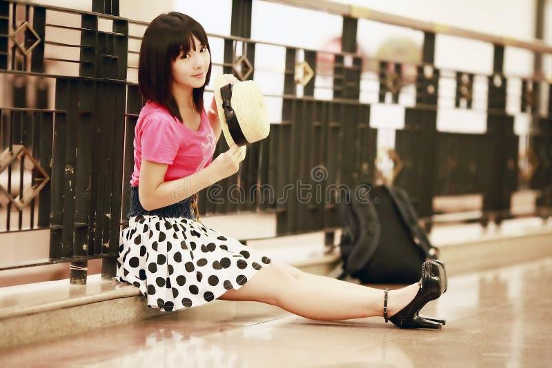 Asian girl relaxing indoor stock image