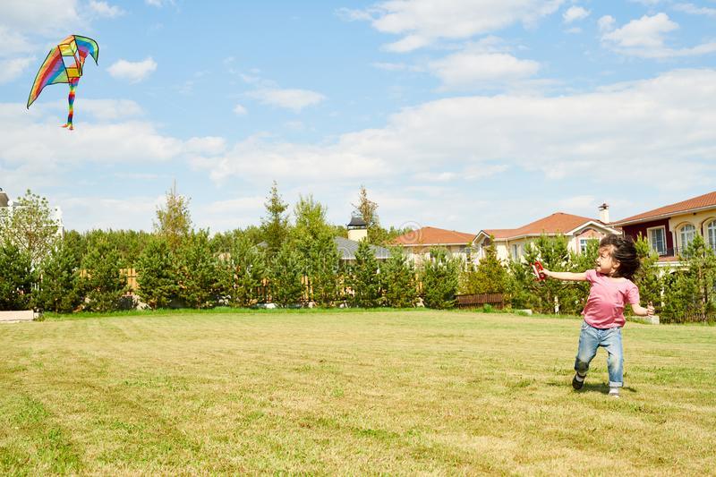 Asian Girl Running with Kite royalty free stock image