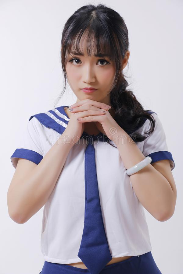 Asian girl and Sailor suit stock image