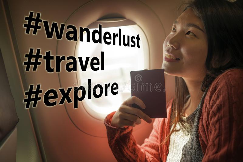 Asian girl sharing travel experience on social media . young happy and beautiful Chinese tourist woman in airplane cabin thinking royalty free stock images