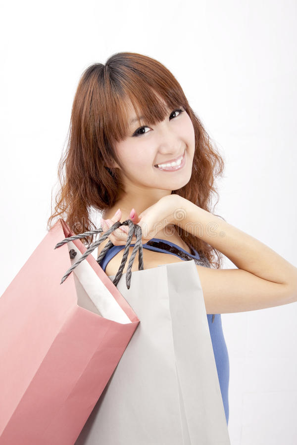 Asian girl with shopping bag stock photo