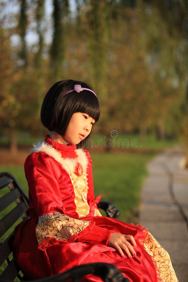 Asian girl sitting on bench