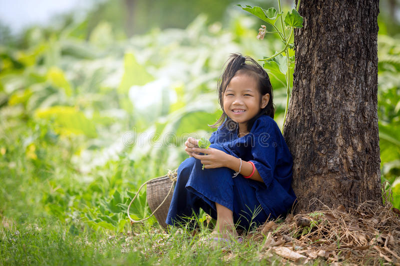 Asian girl sitting smile on the grass in the park stock photo