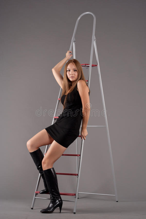 Asian girl sitting on a stepladder stock image