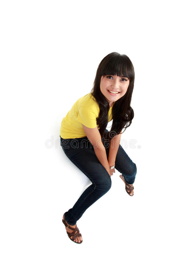 Asian girl sitting on the white table stock photography