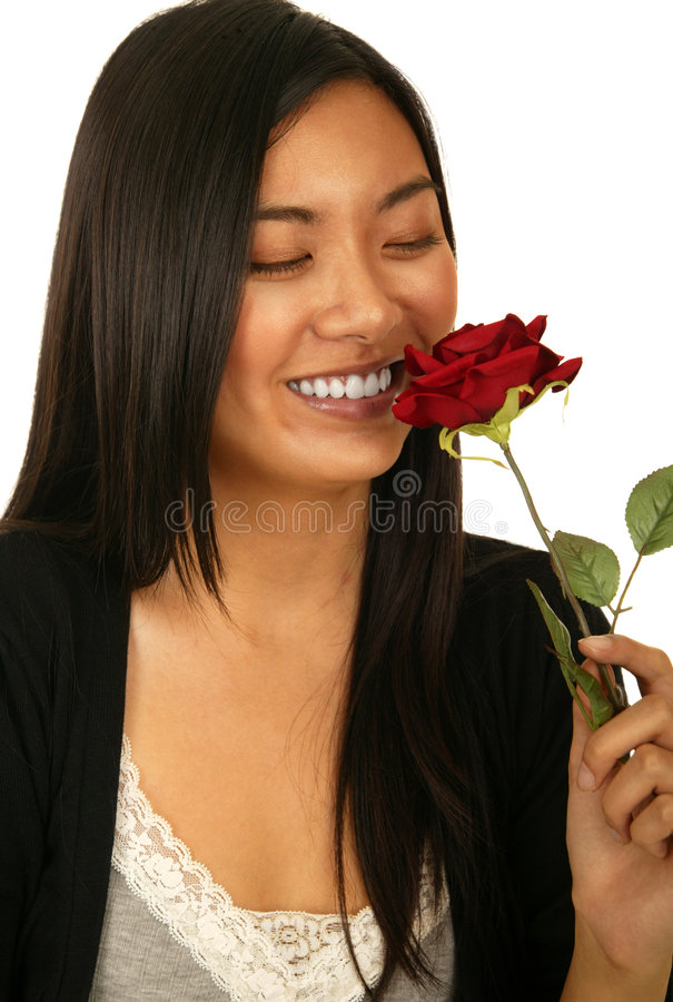 Asian Girl Smelling Rose stock photography