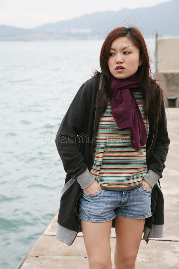 Asian Girl Standing Stock Images