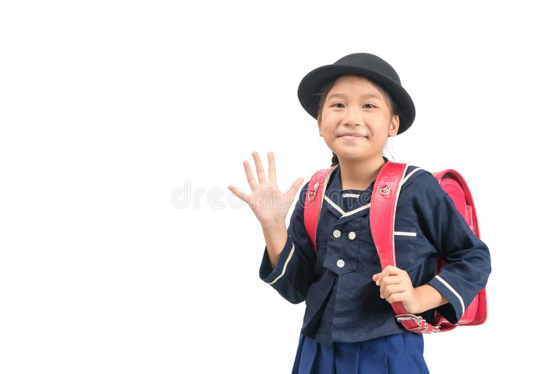 Asian girl student going to school and waving goodbye royalty free stock images