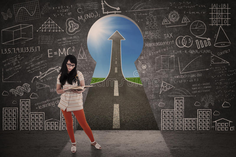 Asian girl study in front of keyhole success road. Asian girl is studying in front of keyhole success road landscape royalty free illustration