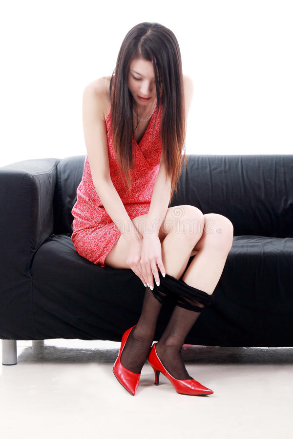 Asian Girl Taking Off Stockings Stock Photography