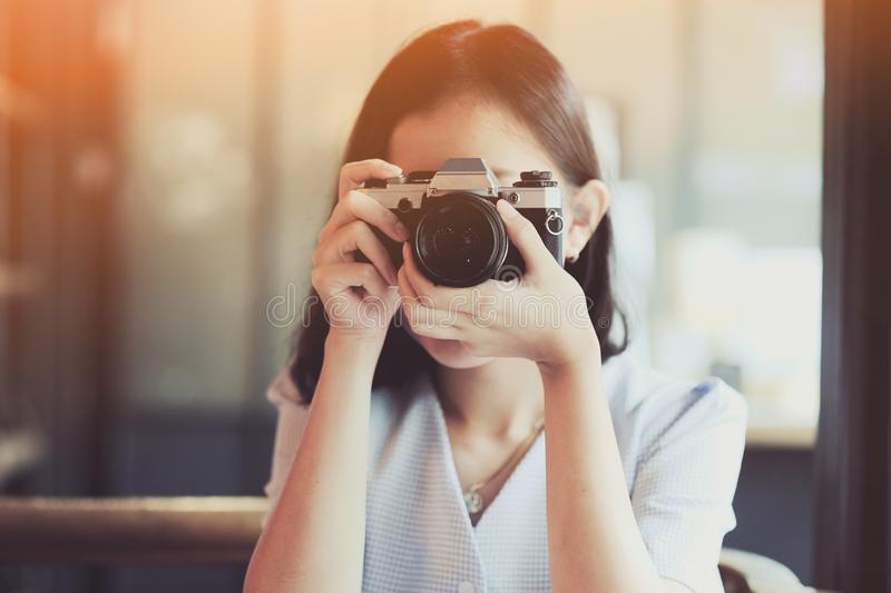 Asian girl taking photo by  SLR Film camera.  royalty free stock images