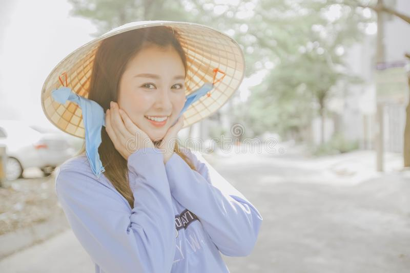 Asian girl with traditional hat royalty free stock images