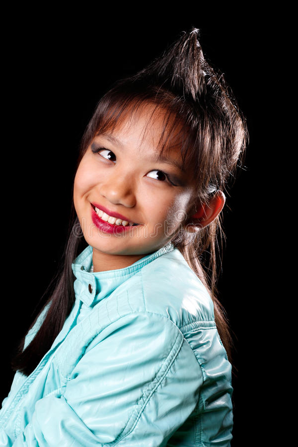 Asian girl with a tuft of hair on his head stock image